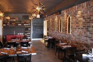 Main dining room at Brick N Fire Restaurant in Bradford